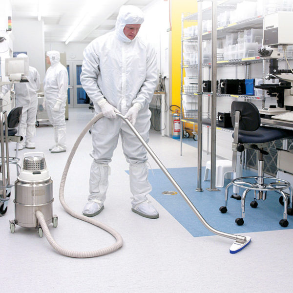 A man in a clean room using the IVT 1000 CR vacuum